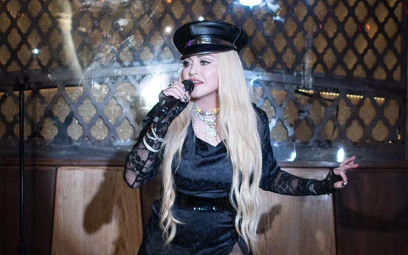 Madonna Slays In High Slit Black Dress During NYC Performance